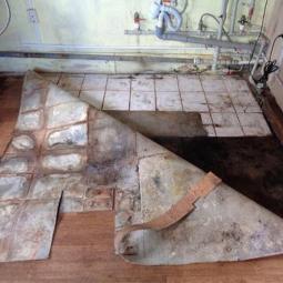 Демонтаж покрытия проклеенного